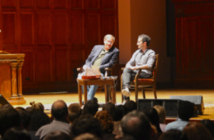 Radiolab co-hosts and Oberlin alumni Robert Krulwich and Jad Abumrad on the stage of Finney Chapel, Sept. 19, 2014. Photo: Jonathan Jue-Wong